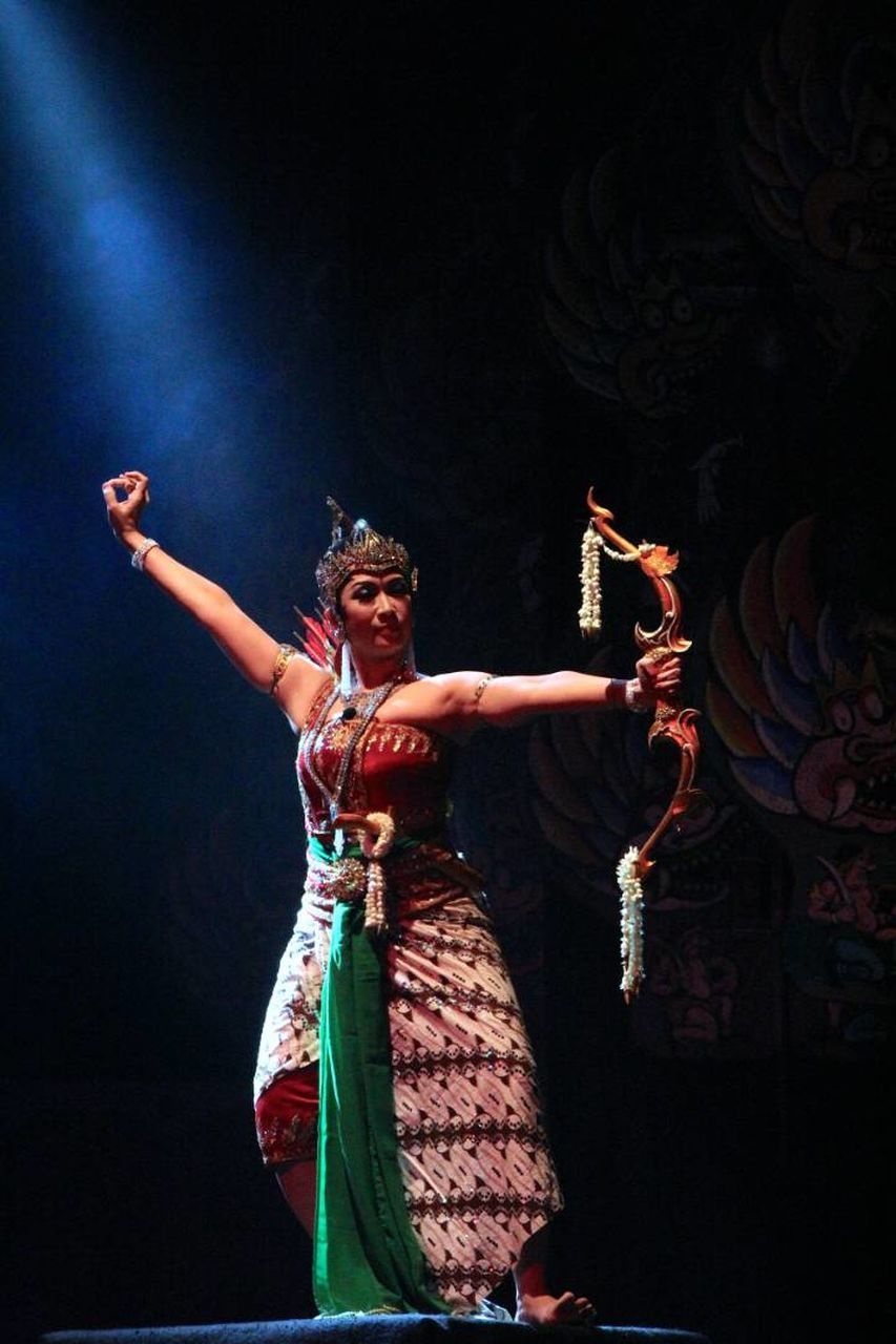 performance, performing arts event, stage costume, costume, young adult, one person, cultures, dancing, young women, real people, arts culture and entertainment, dancer, celebration, full length, indoors, standing, lifestyles, night, portrait, actor, adult, people