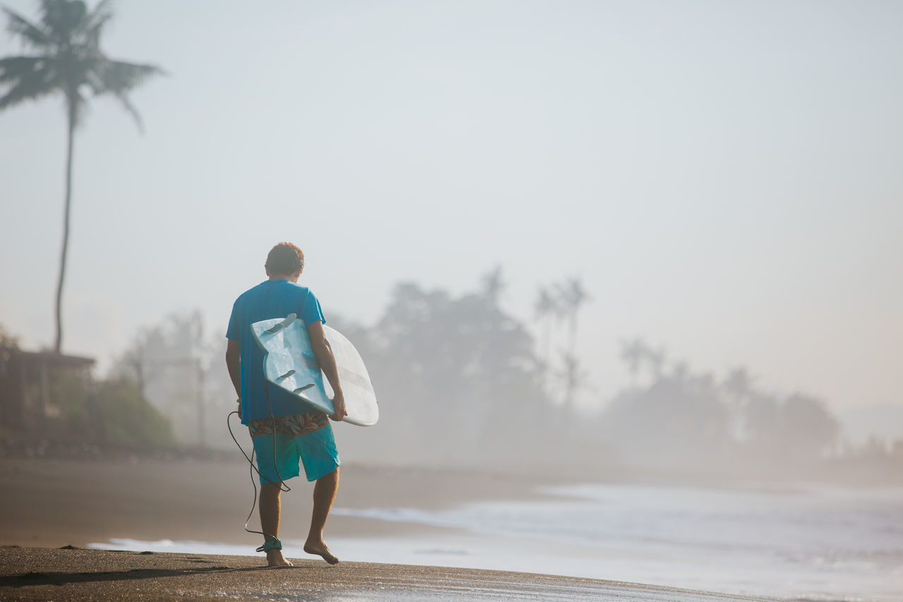 Surfing themed photo Adult Bali Beauty In Nature Day Fog Full Length INDONESIA Leisure Activity Lifestyles Live For The Story Ocean One Person Outdoors People Real People Rear View Sky Surf Surfer Surfing Walking Young Adult