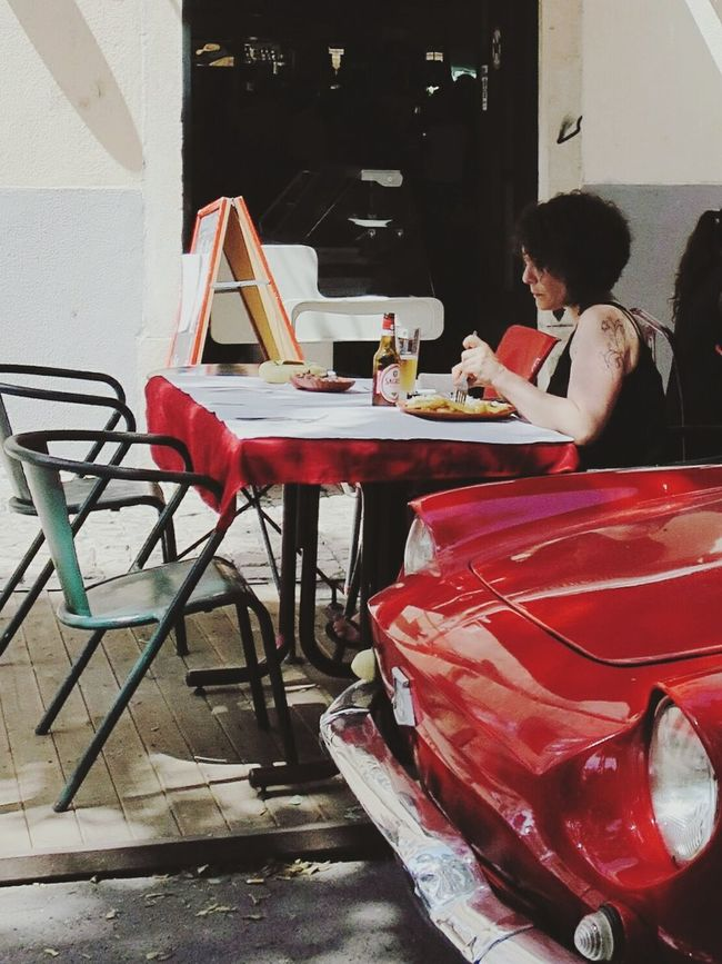 Table for two. Red Restaurant Dining Traveling Taking Photos Outdoors Full Length Travel Destinations Travel Photography Travel Person Alfama Capture_today Capitalcity People On The Street Peoplephotograpy People Around You Peoplewatching