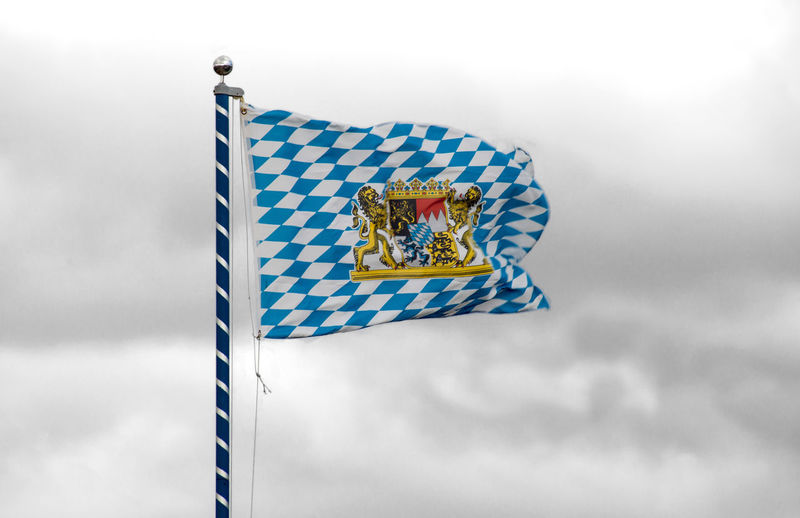 Unofficial Flag of Bavaria with national emblem Bavaria Bavarian Blowing Blue Cloudy Coat Of Arms Cultur Diamond Flag Flag Flagpole Germany Golden Hoisted Banners Identity Lion Mast Multi Colored National Emblem National Flag Patriotism Sign Sky Symbol Tradition Wind