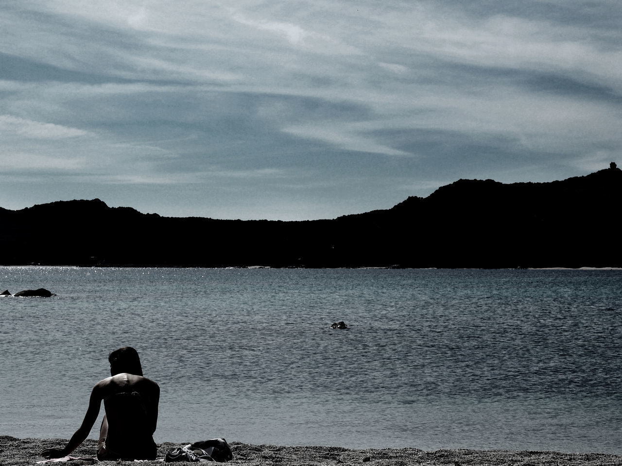 Beauty In Nature Bird Day Leisure Activity Lifestyles Men Mountain Nature Outdoors People Real People Rear View Scenics Sea Silhouette Sky Standing Swimming Tranquility Water