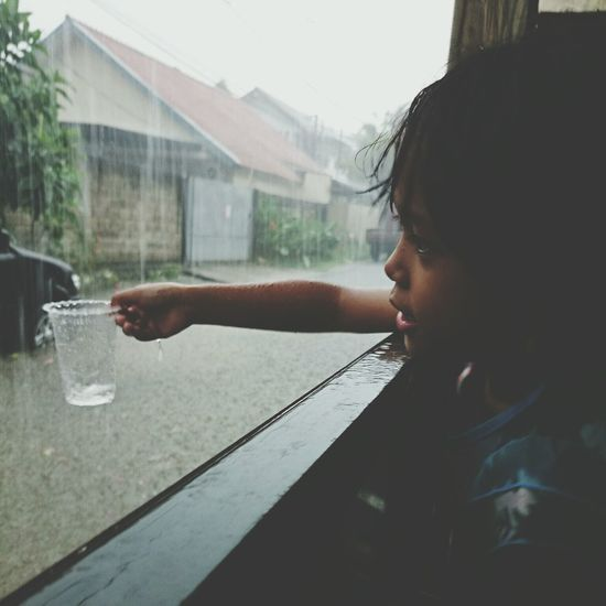 A Girl Playing In The Rain