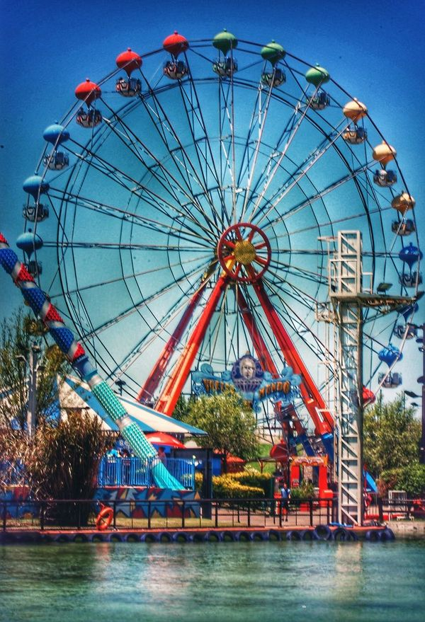 Ferris Wheel Amusement Park Illuminated Arts Culture And Entertainment Amusement Park Ride Traveling Carnival Sky Outdoors Architecture Large Group Of People Day People Parque  Vueltaalmundo Buenos Aires, Argentina  Buenos Aires, Argentina  Rio No People Cielo