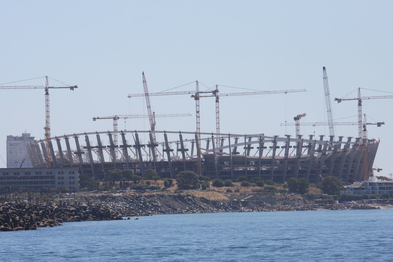 Building Up Construction Cranes Construction Site Day No People Outdoors Soccer Stadium Water