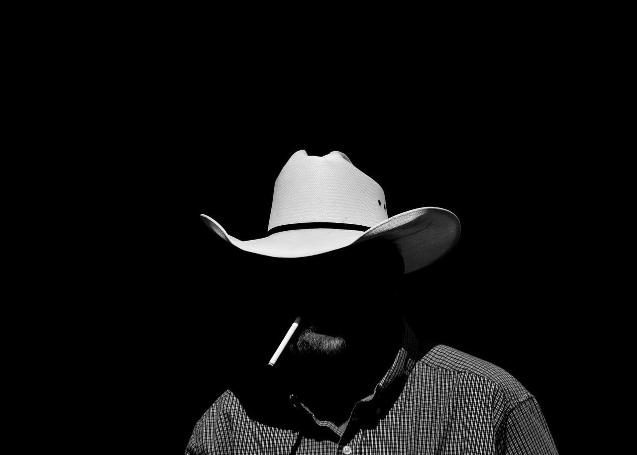 Smokin' Cowboy - Black Background one person headshot mature adult one man only bnw_life bnwphotography streetphotographer bnw_collection bnw_demand bnw_captures bnw_diamond bnw_magazine EyeEmNewHere bnw_planet Street portrait bnw_society men streetphotography_bw streetphotography streetphoto_bw bnw_shot portrait 365 Black Background real people