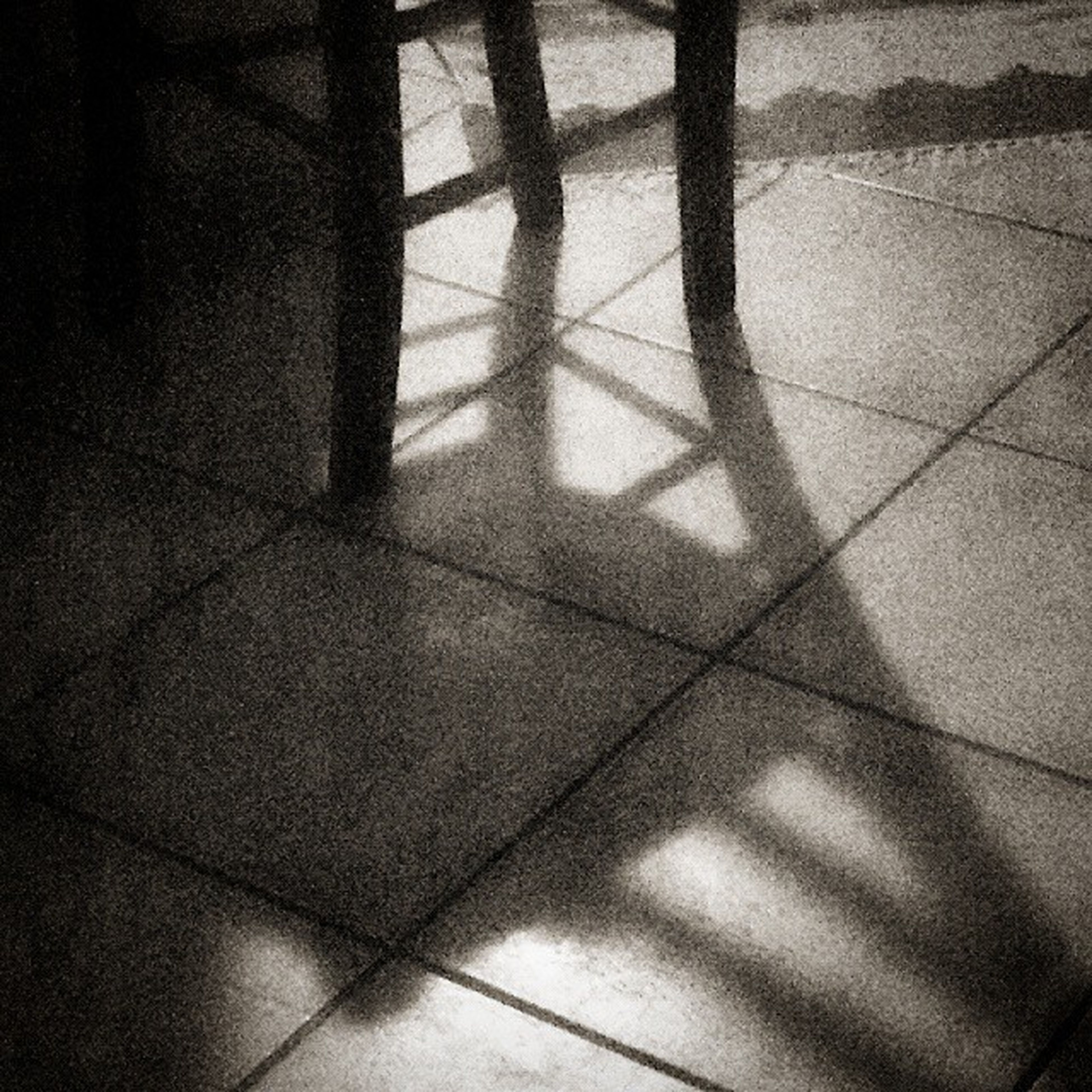 indoors, tiled floor, flooring, shadow, tile, high angle view, wall - building feature, pattern, floor, sunlight, home interior, empty, absence, no people, wall, day, geometric shape, close-up, paving stone, auto post production filter