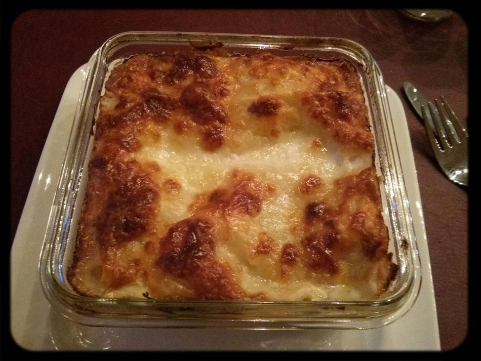 Enjoying dinner: leek rocket mozzarella lasagna Dolce Far Niente
