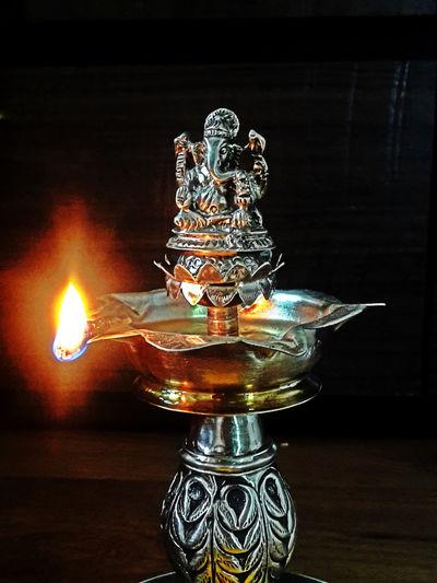 Worshipping Flower Worship Ganpati Oil Divas Oil Lamp Diya Akshaytritiya Satyanarayan Satyanarayanpooja Silverware  God God's Beauty God Bless Love Photography My Photography Love To Take Photos ❤ Check This Out! Still Life