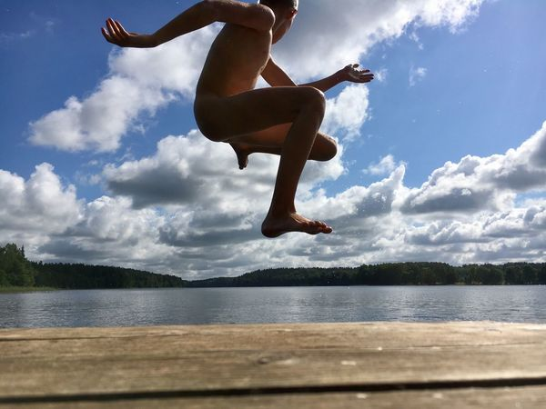 Free style jump Barefoot Beauty In Nature Cloud - Sky Day Energetic Full Length Jumping Lake Low Section Mid-air Nature One Person Outdoors People Sky Tree Water Young Adult