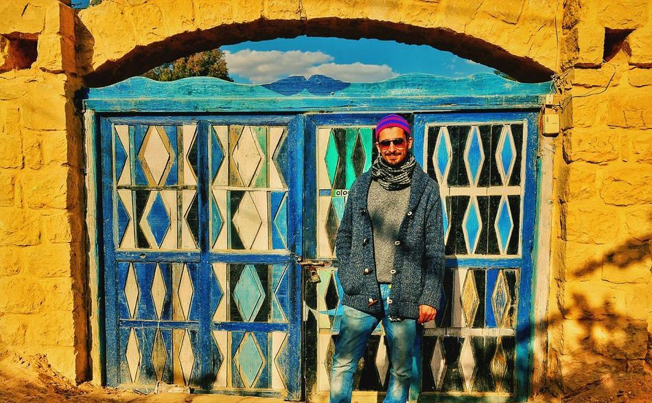Street Art Multi Colored Outdoors One Person Real People Day Architecture Sky Growth Vacations Colored Door Doorsworldwide Tranquility This Is Egypt ❤ My Egypt Resolution Travel Destinations Fayoum Egypt Backgrounds Beauty In Nature Building Exterior Architecture Built Structure Tourism Natural Pattern Travel