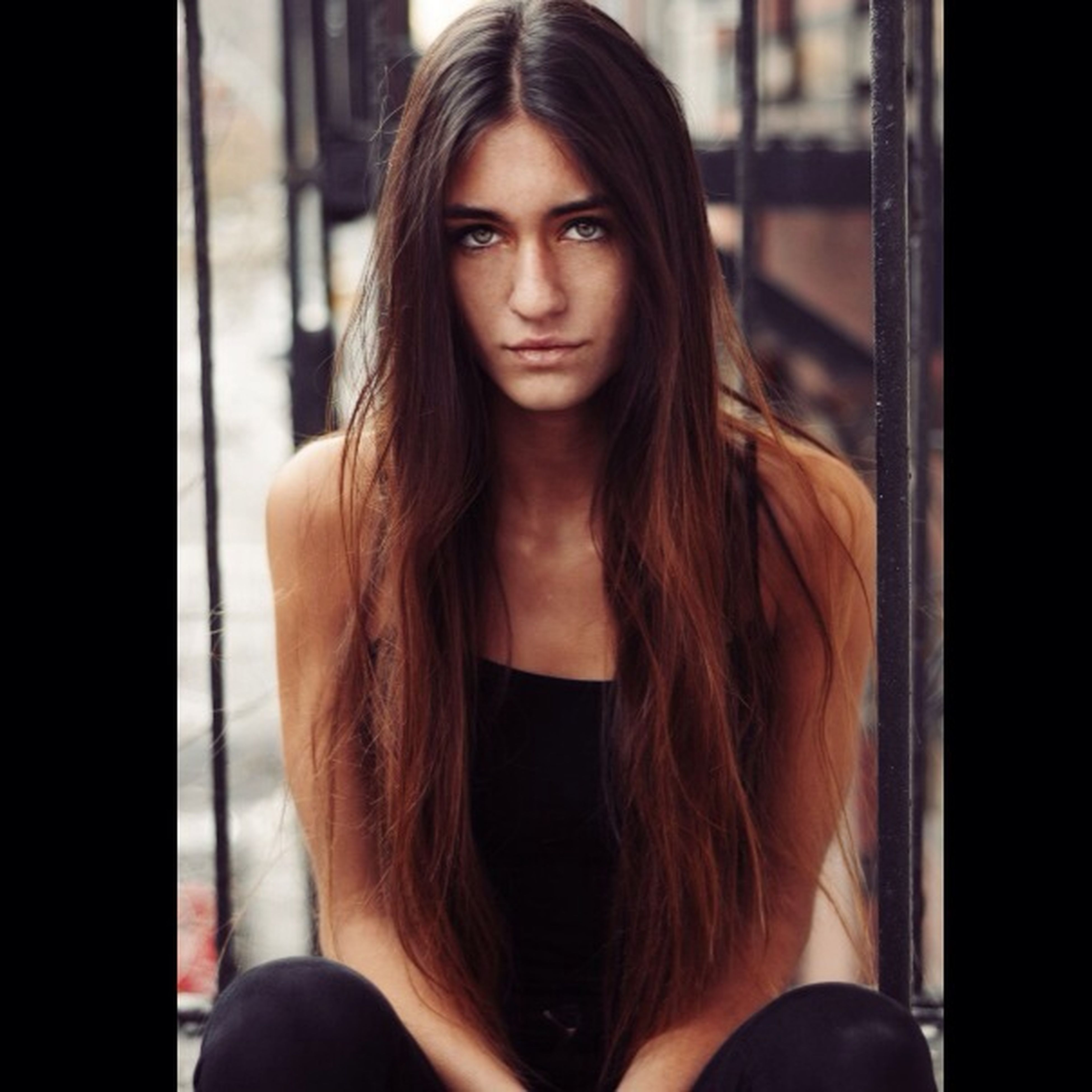 young adult, young women, long hair, lifestyles, person, portrait, looking at camera, front view, leisure activity, casual clothing, brown hair, standing, medium-length hair, headshot, smiling, waist up, indoors