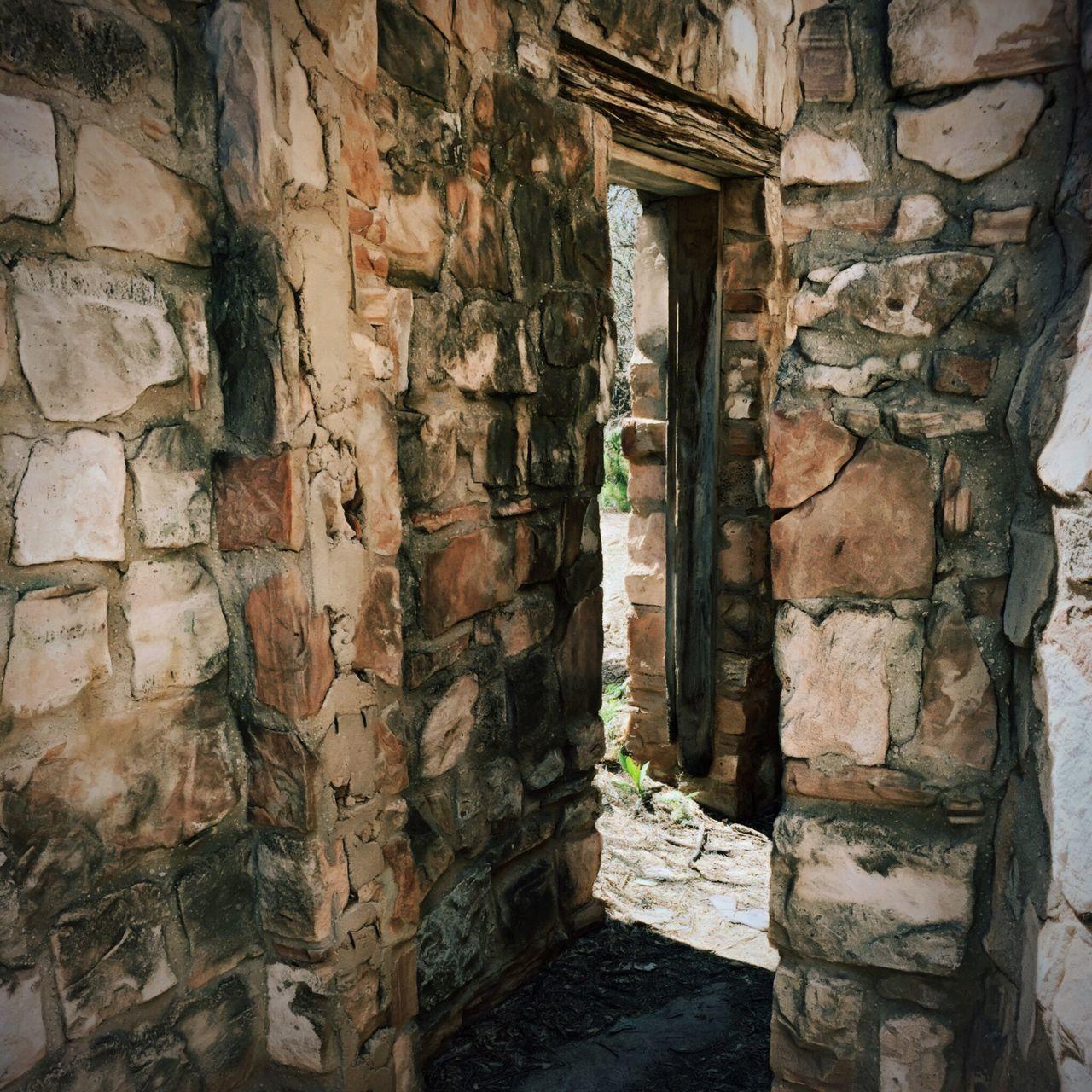 Narrow Walkway Along Stone Walls