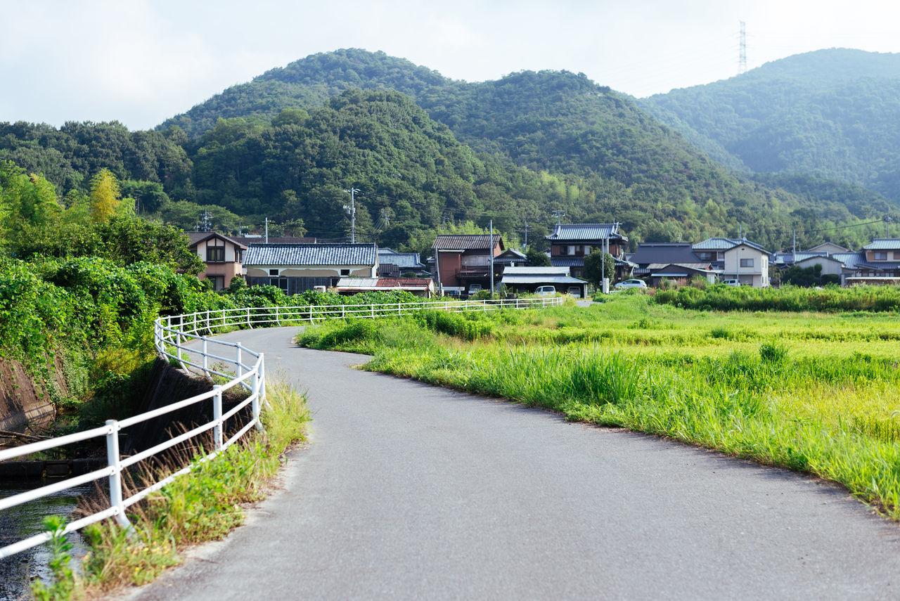 Japanese village in Okayama Architecture Beauty In Nature Building Exterior Built Structure Day Grass Japanese Village Landscape Mountain Nature No People Outdoors Road Rural Scene Scenics Sky The Way Forward Tranquil Scene Tranquility Tree