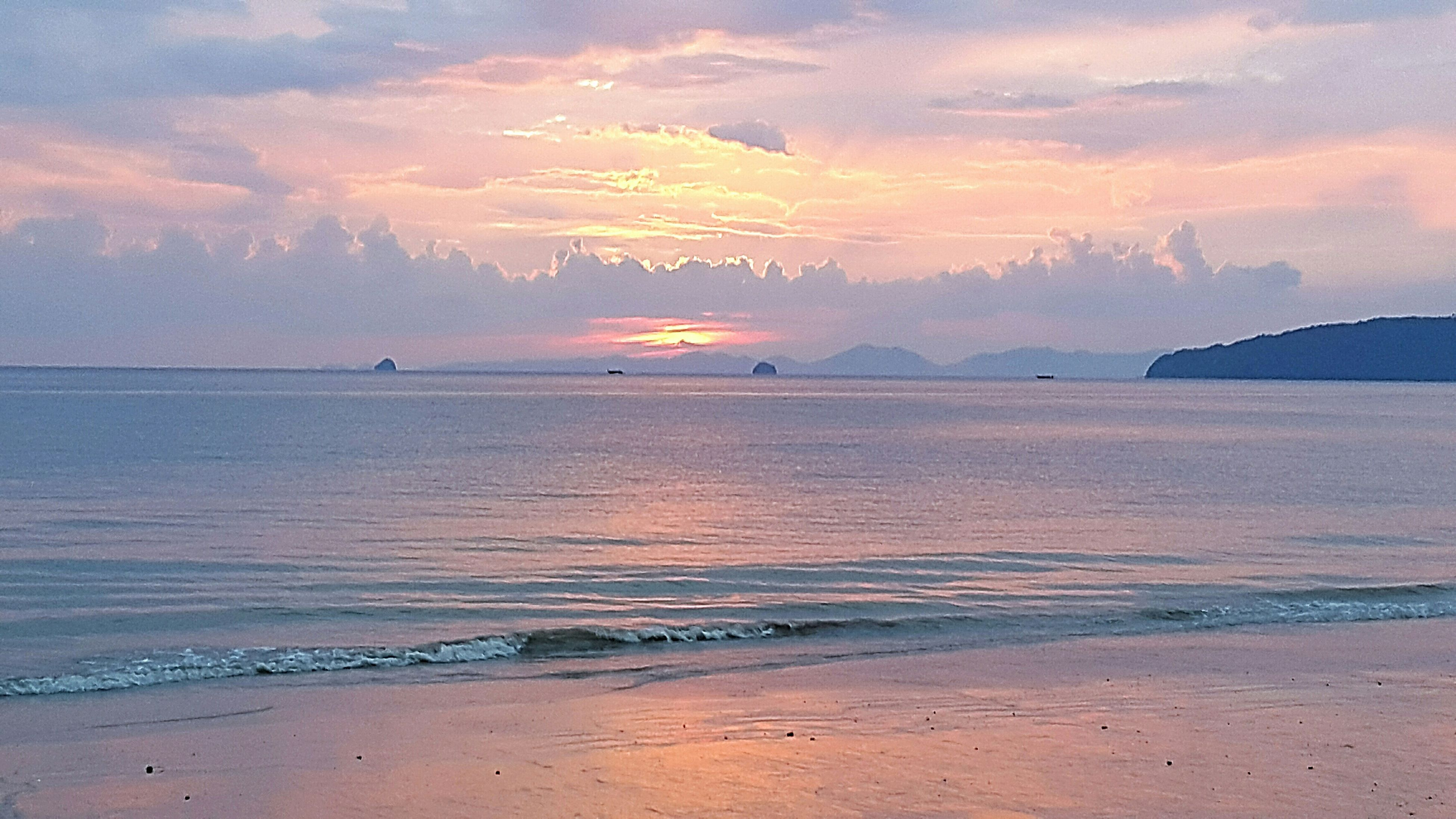 water, sea, tranquil scene, scenics, sunset, sky, tranquility, beauty in nature, beach, horizon over water, cloud - sky, shore, idyllic, nature, cloud, orange color, sand, coastline, reflection, cloudy