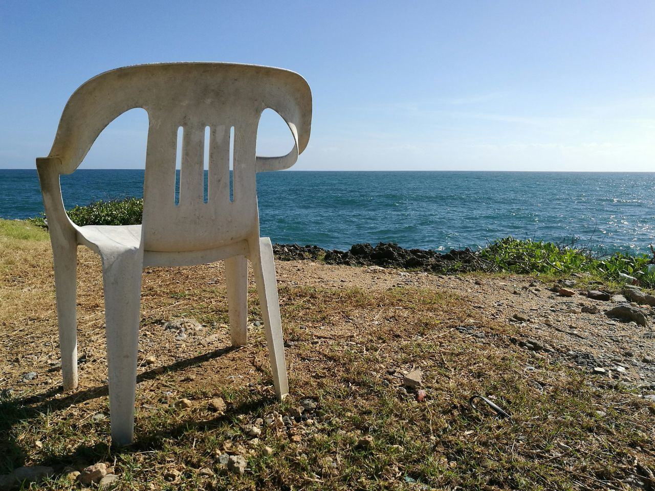 Loner | Sea Horizon Over Water Clear Sky Water Sunlight Blue Travel Destinations Sky Outdoors Shadow Nature Scenics Beauty In Nature No People HuaweiP9 Huaweiphotography Chair Chairs Chairs Seats Chair In Garden Chairs In Nature Chairs Perspective Chairs Outside Chairstories