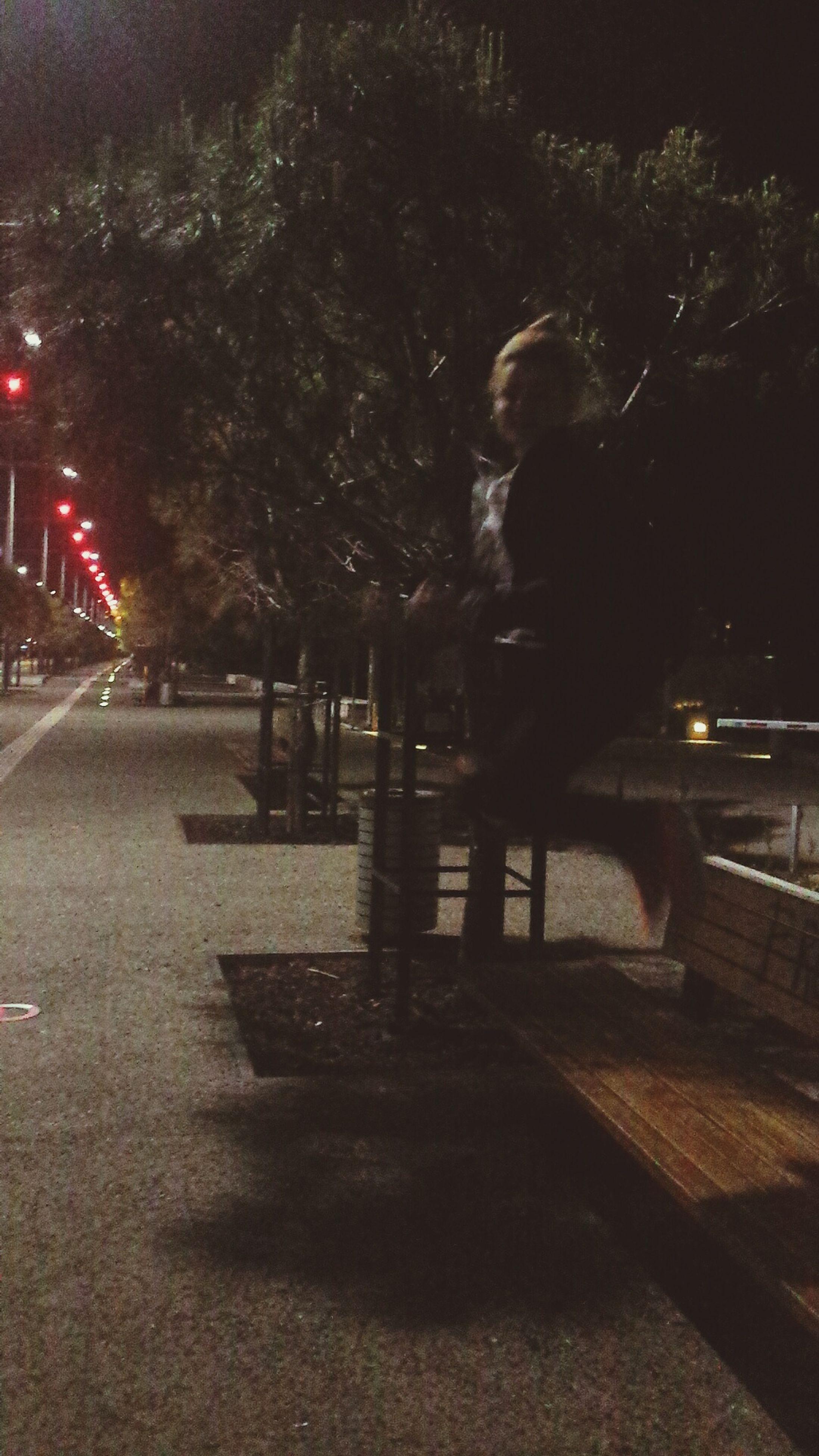 night, illuminated, street, road, street light, the way forward, transportation, walking, city, road marking, tree, lifestyles, sidewalk, men, full length, silhouette, outdoors, rear view