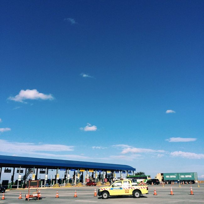 The skies are blue and cars pass through Highways Photography Cavitex Sky Road