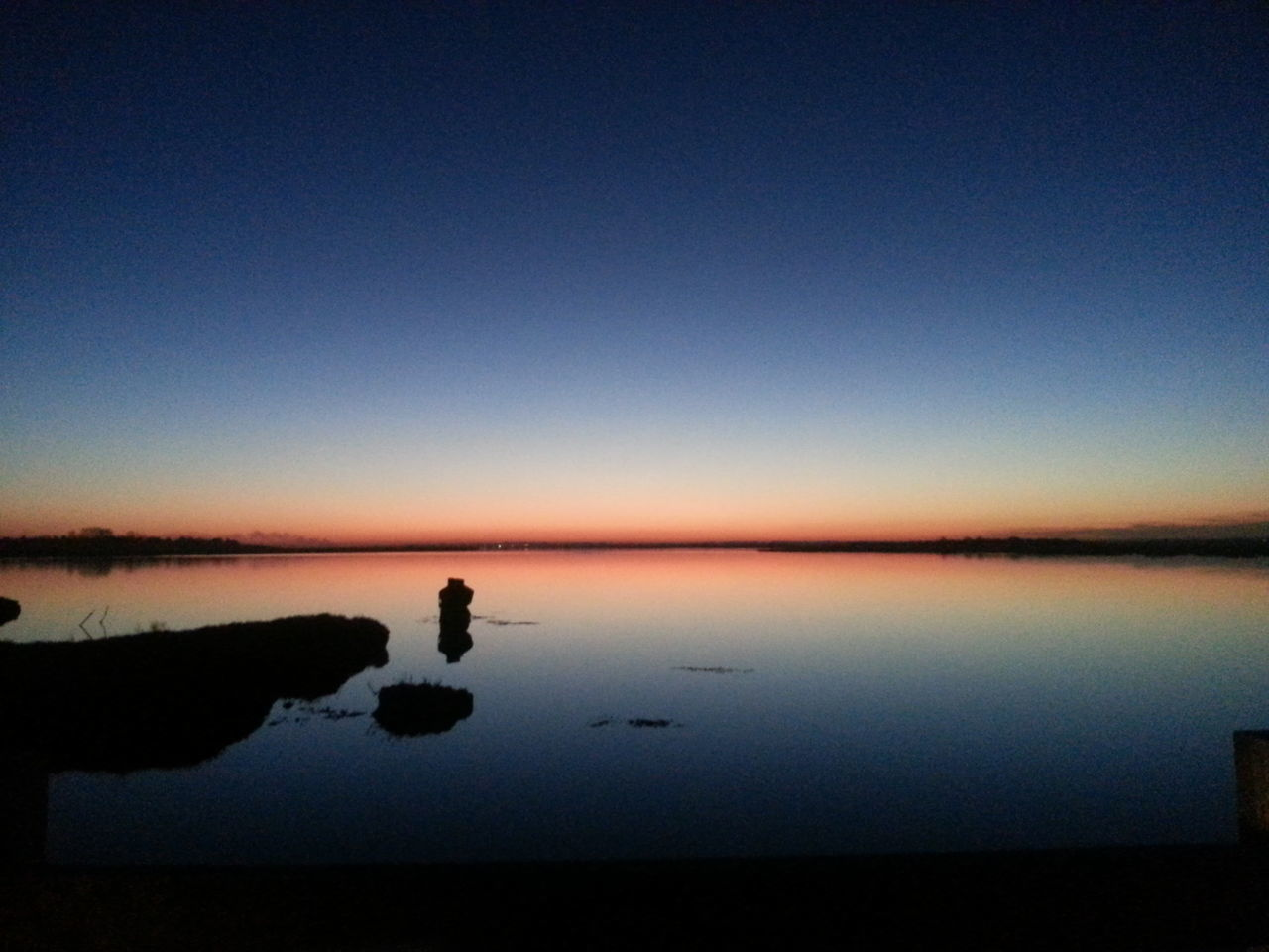 Taken on the Mersea Strood at dusk Reflection Sunset Water Sky Blue Silhouette Tranquility Scenics Lake Beauty In Nature Standing Water Horizon Over Water Nature Clear Sky Beach Outdoors Salt - Mineral First Eyeem Photo