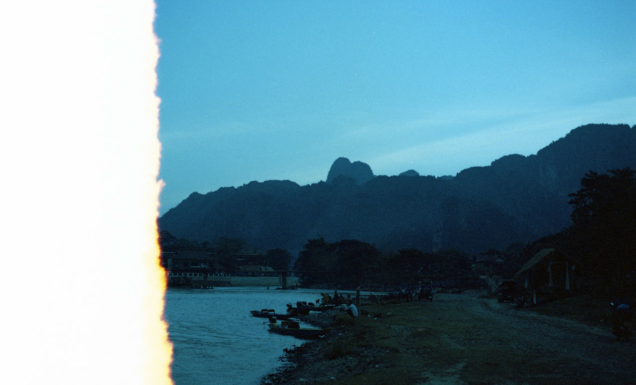 Sunset in Vang Vieng, Laos. 35mm Film Agfa Vista200 Agfavista200 Analog Camera Analogue Photography Beauty In Nature Blue Buy Film Not Megapixels CanonA1 Clear Sky Film Is Not Dead Film Photo Film Photography Filmisnotdead Laos Nature River Sky Vangvieng