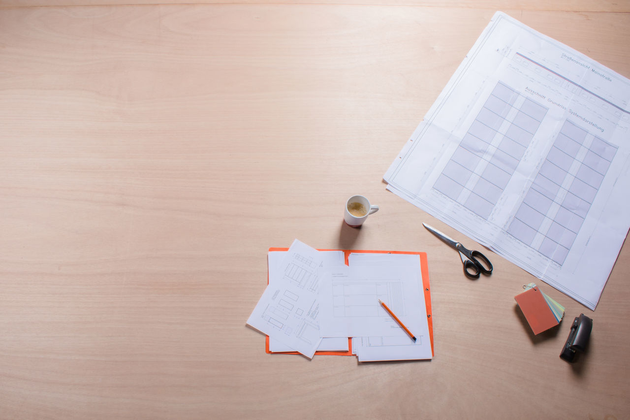 Table view ground plot, documents, plans on wooden table Architecture Binder Briefcase Cup Of Coffee Desk Desktop Documents File Folder Footprint Building Ground Plot Making Plans No People Office Paper Paperwork Pencil Plan Scissors Table View Topview Wood Work Working Working Desk