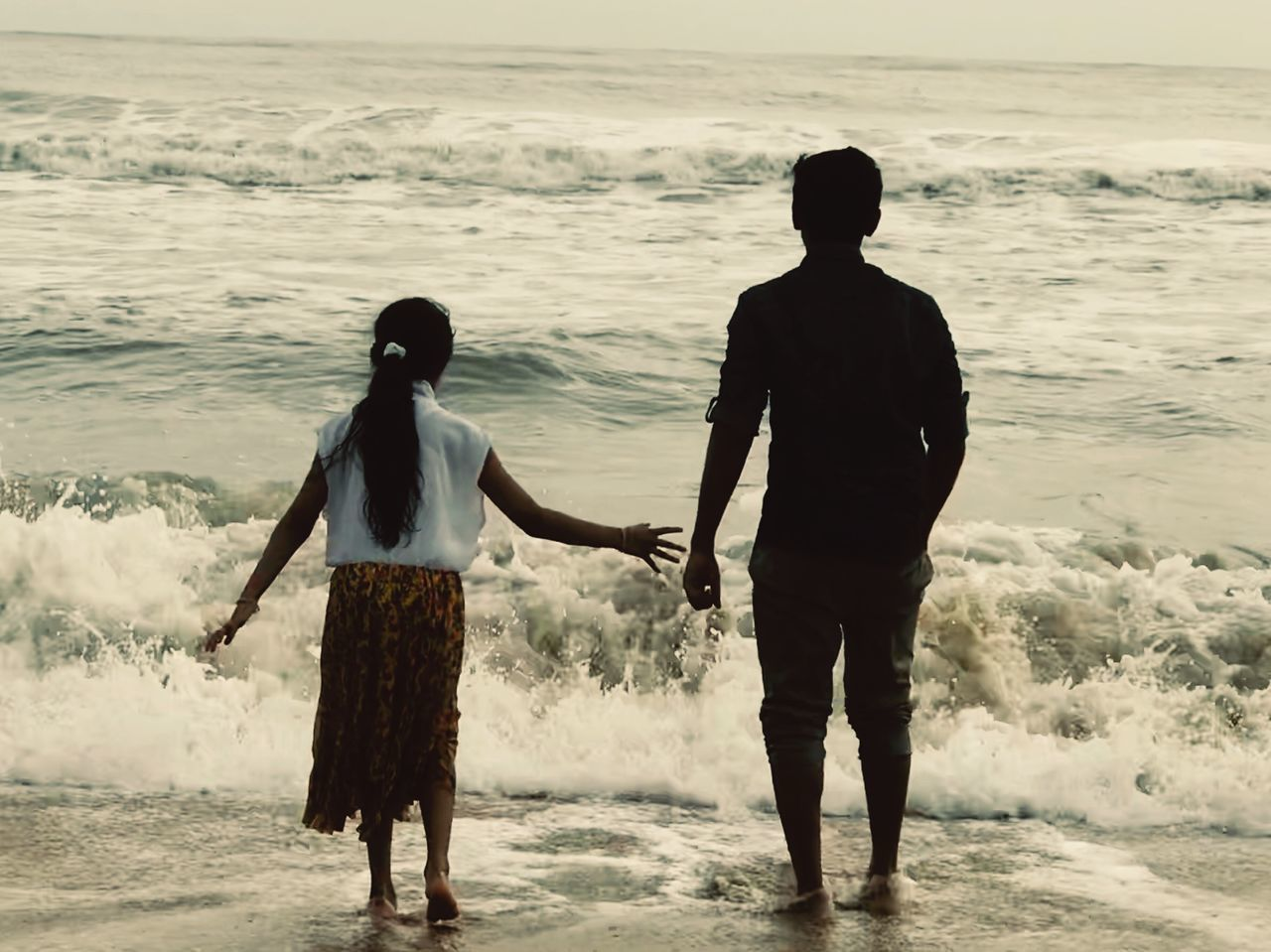 two people, beach, sea, real people, standing, love, water, sand, togetherness, wave, men, rear view, full length, leisure activity, sunset, nature, lifestyles, women, young women, day, outdoors, beauty in nature, bonding, horizon over water, sky, young adult