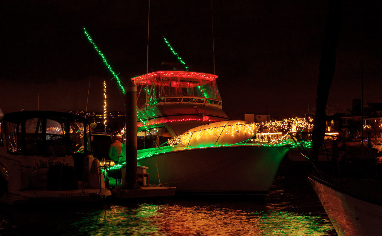 Newport Beach, CA, USA -December 16, 2016: Colorful holiday lights on sailboats and ships in the Balboa Harbor for the Newport Beach Christmas Boat Parade. Editorial use only. Boat Dock Boat Ride Christmas Christmas Decorations Christmas Lights Festive Harbor Holiday Lights Night No People Ocean Ocean View Outdoors Parade Sail Sailboat Water