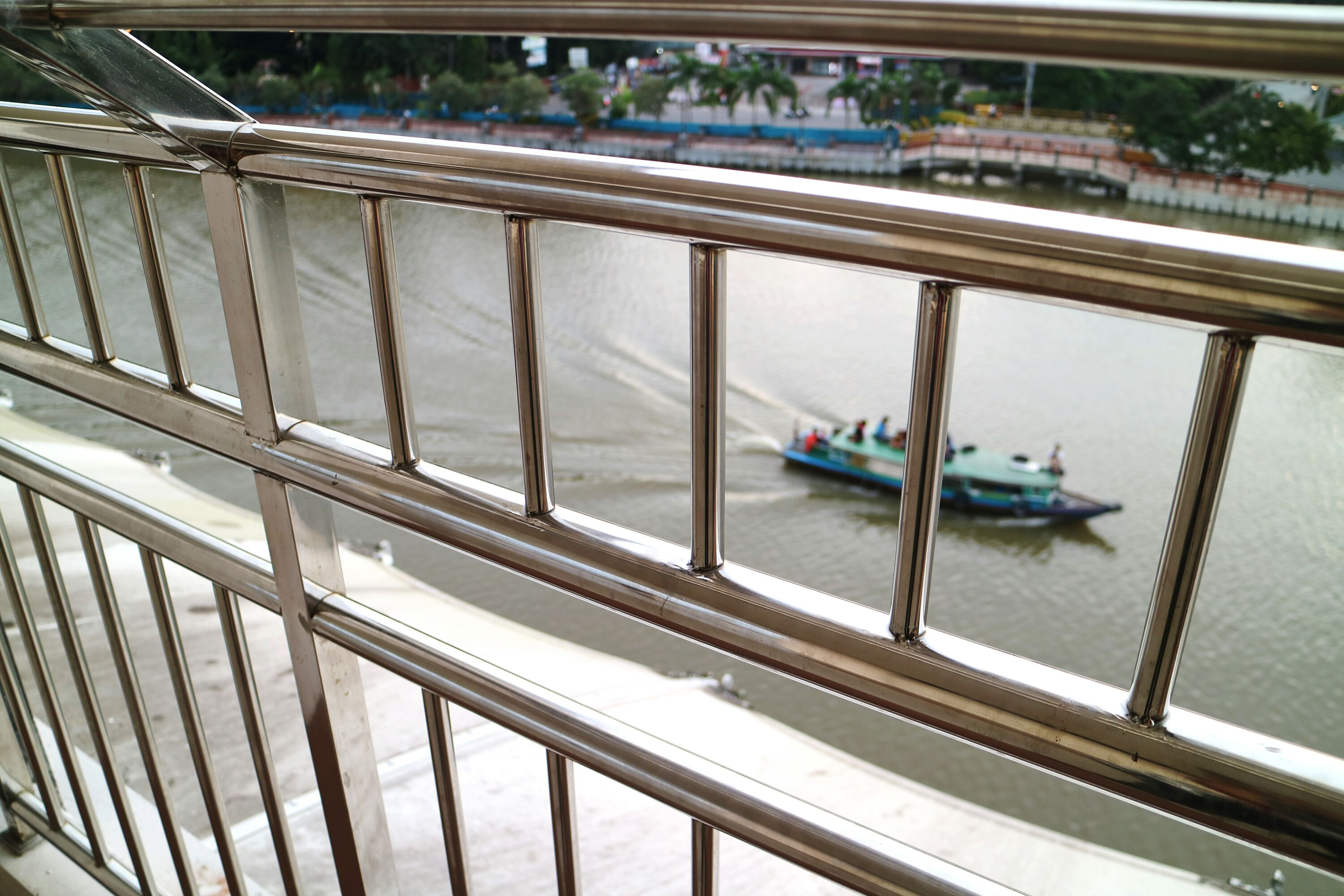 railing, transportation, built structure, architecture, mode of transport, high angle view, nautical vessel, bridge - man made structure, steps, day, metal, boat, staircase, connection, water, outdoors, sea, no people, travel, low angle view