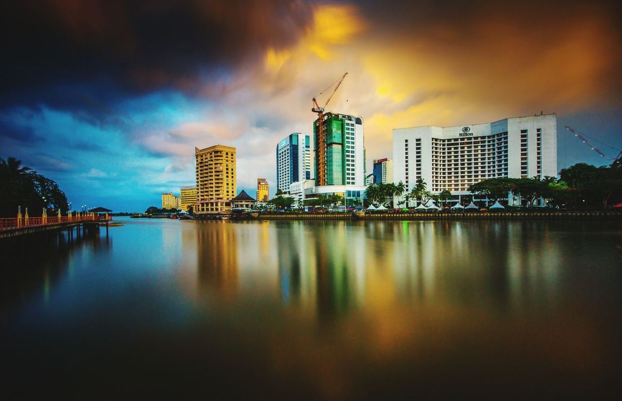 Urban Skyline City Cityscape Reflection Skyscraper Architecture Travel Destinations Travel Water Sunset Night Bridge - Man Made Structure Tree Outdoors Multi Colored Dramatic Sky Vacations Building Exterior Landscape Kuching_waterfront High Angle View Beauty In Nature Tranquility Waterfront Transportation