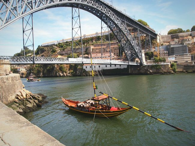 Douro river River Douro  Bridge Porto Portugal Boat Wood Iron Barrels Transport Vintage Outdoors Water Architecture Life No People Eyeemphotography EyeEm Gallery Colors Calm Placid
