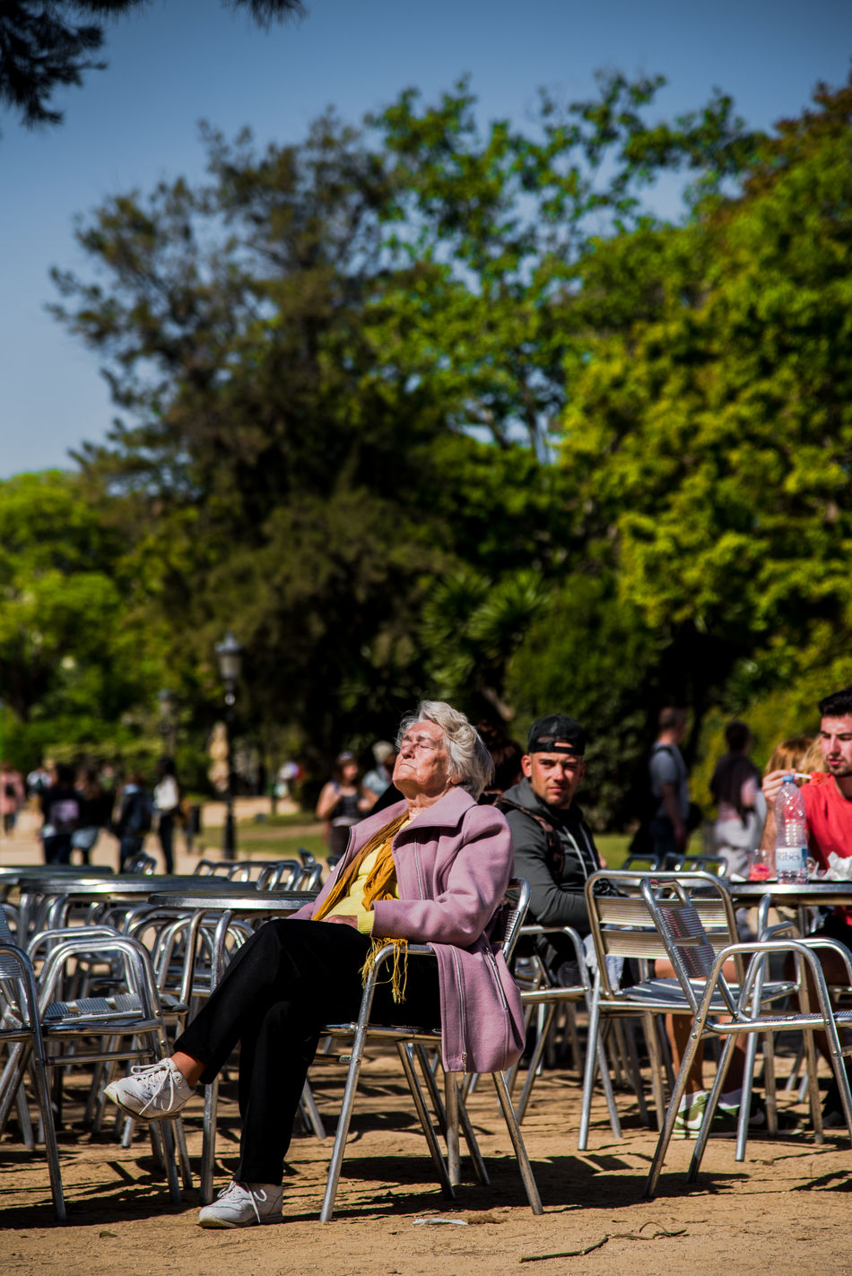 Chair City City Life Day Enjoying Life Focus On Foreground Leisure Activity Lifestyles Men Outdoors Park People Portrait Real People Senior Adult Senior Women Sitting Sky Spring Springtime Sun Sunbathing Sunlight Sunny Table