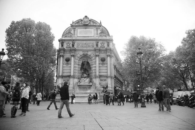 Architecture Building Exterior Built Structure City City Life Clear Sky Day Fontaine Saint-Michel Paris Fountain France Large Group Of People Lifestyles Men Mixed Age Range Outdoors Paris People Statue Street Streetphotography Travel Travel Destinations Tree Walking