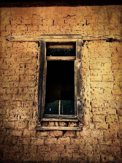 """""""Soulless"""" A home without the people who give it life, happiness or even strife, once abandoned, no one left to care, ghostly entry, if you dare, where once living made it whole, now lost and without a soul. New Mexico Photography New Mexico, USA Poetry In Pictures Poetry Weathered Adobe Souless Abandoned Buildings Abandoned Places Abandoned Windows Architecture Window Built Structure No People Low Angle View Building Exterior Day"""