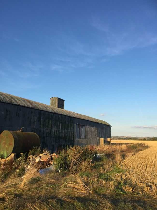 Architecture Built Structure Abandoned Cloud Old Sky Transportation Blue Damaged Day Discarded Destruction Weathered Obsolete Outdoors Surface Level Rural Scene Agriculture Farm Remote Barns Drive Home Building Exterior