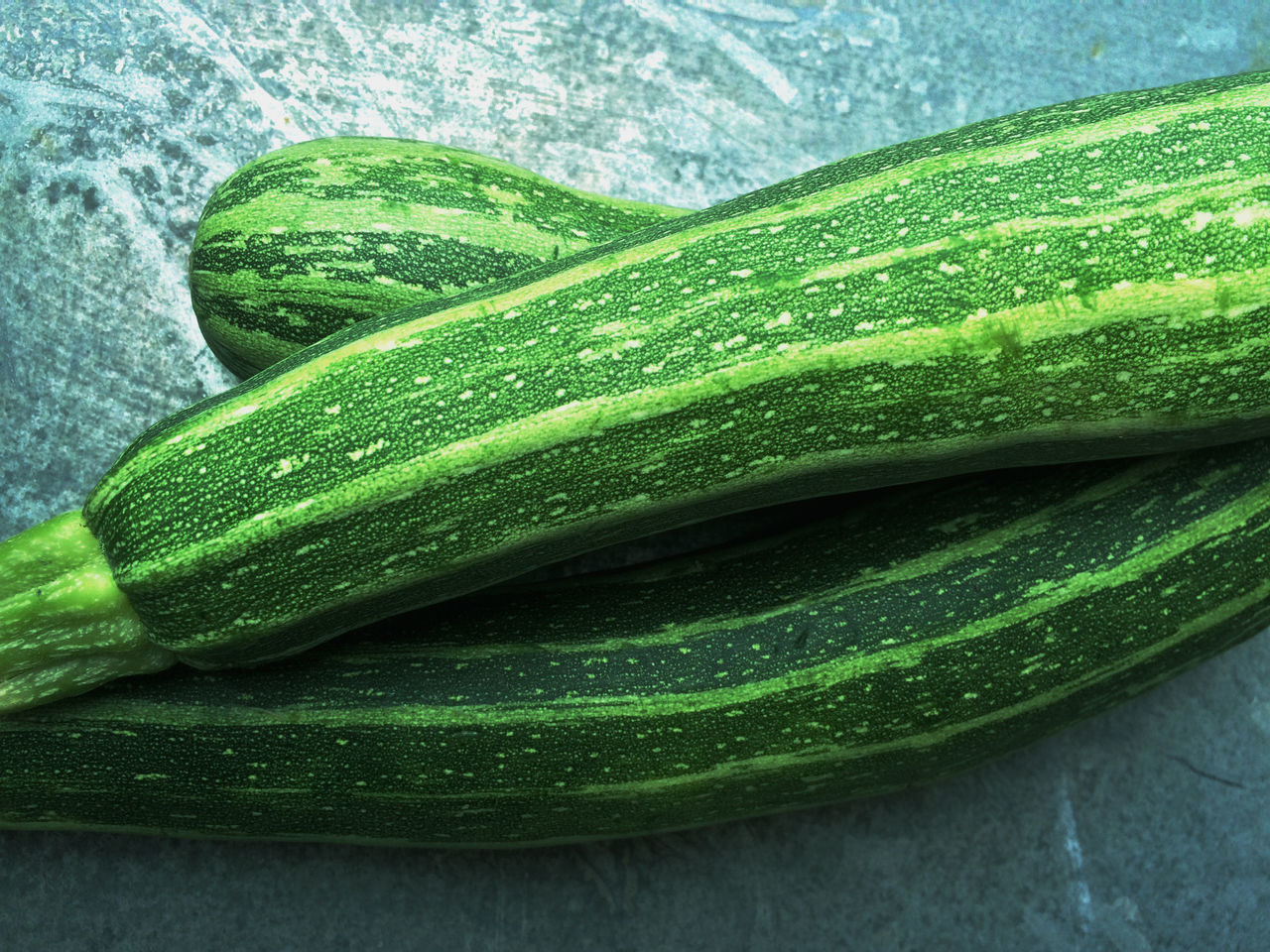 Close-Up Of Zucchinis On Table