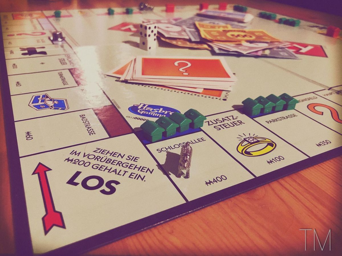 Indoors  Table Text No People Paper Communication Close-up Envelope Day Monopoly Game Hard No Furious Playing Playground Germany Kempten (Allgäu) Spiel Hart Aber Fair Keine Gnade Schlossallee Hotel Haus House Figure
