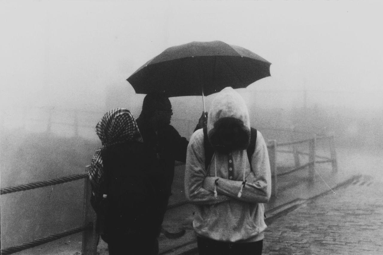 Dark Film Horror Lifestyles Nature Outdoors Rain Rainy Season Real People Standing Umbrella Weather