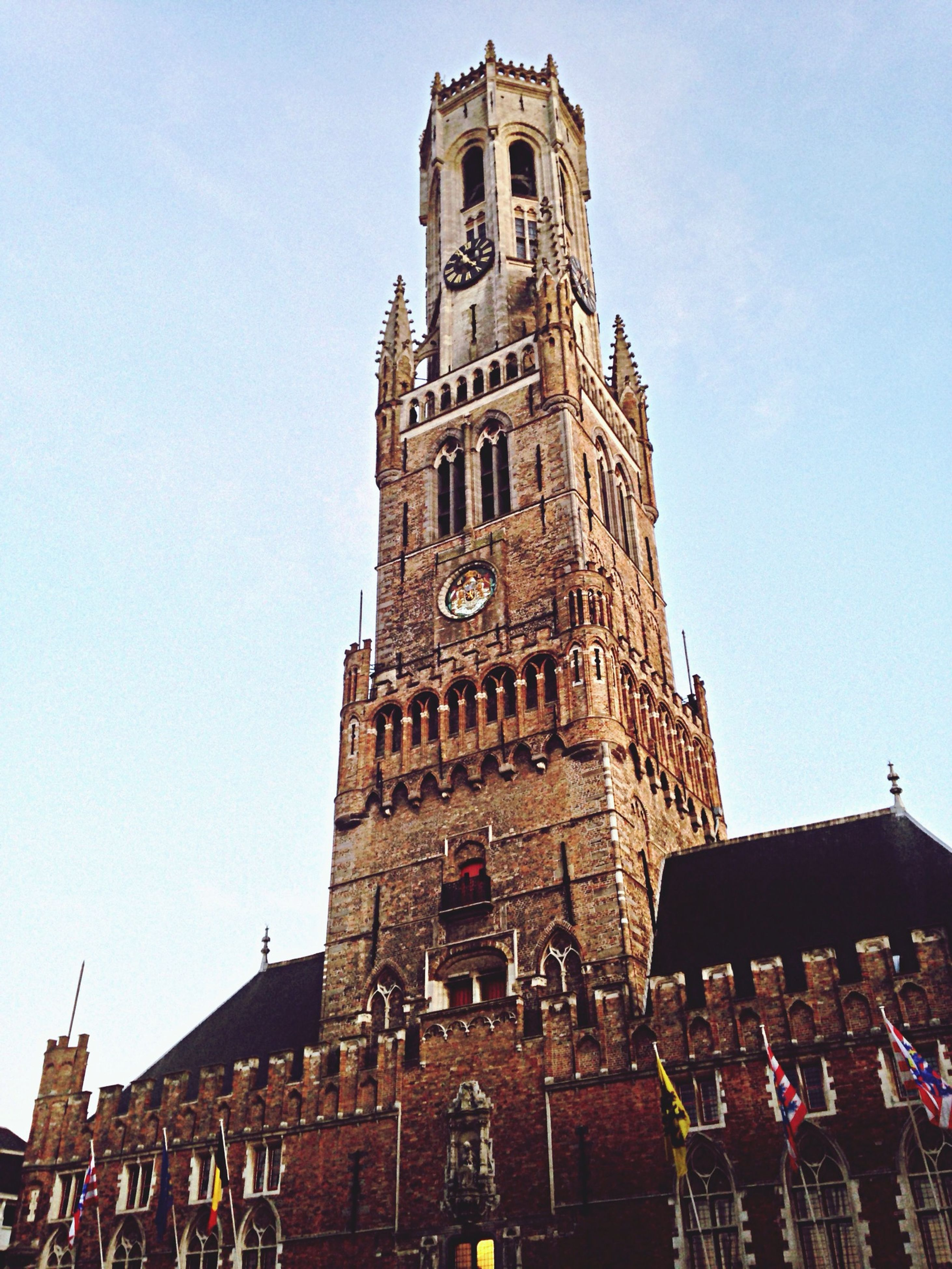 architecture, building exterior, built structure, clear sky, low angle view, history, tower, clock tower, travel destinations, famous place, religion, place of worship, tourism, old, copy space, travel, spirituality, city, church