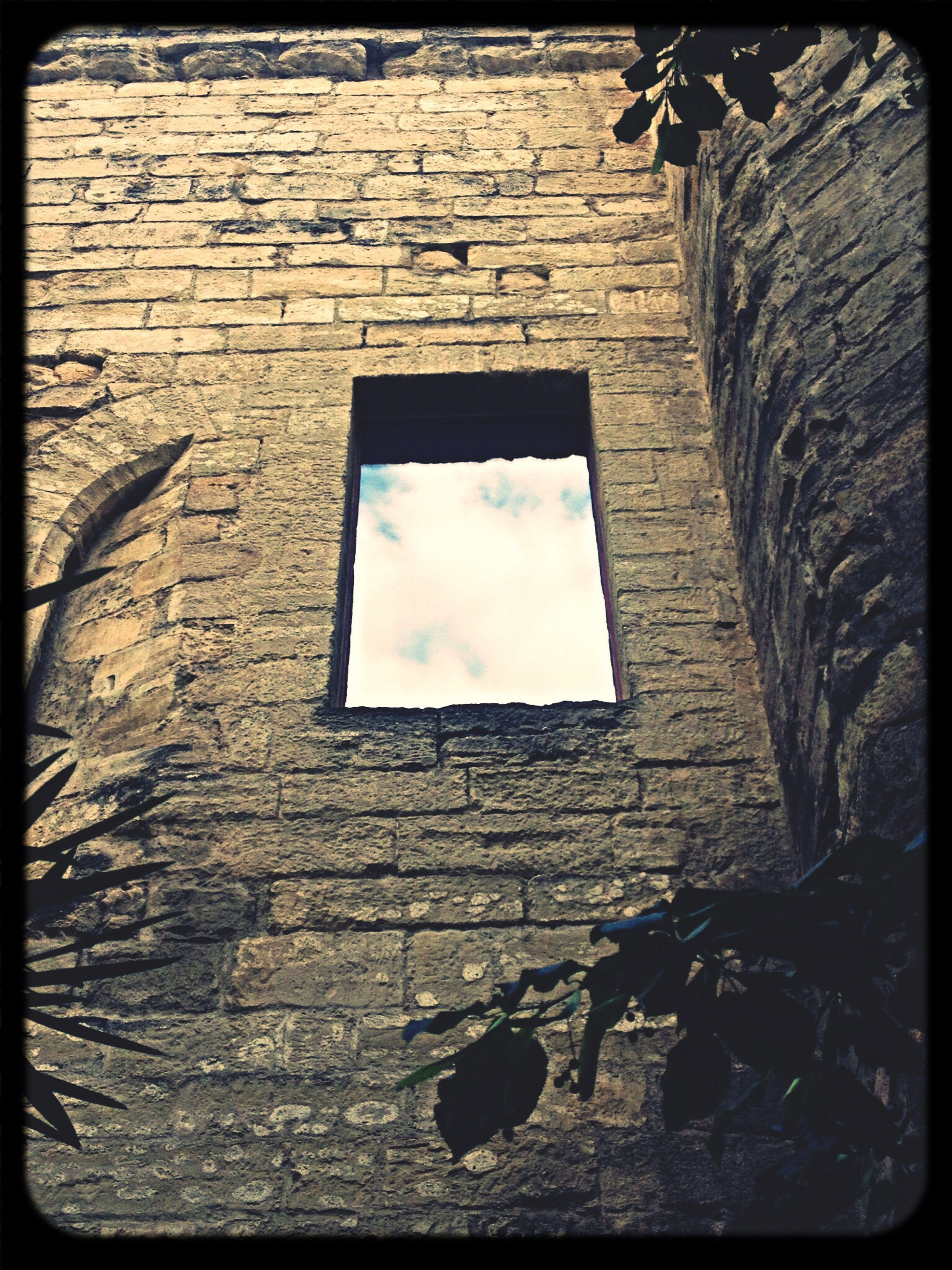 transfer print, architecture, built structure, building exterior, auto post production filter, low angle view, window, brick wall, wall - building feature, building, day, no people, sky, outdoors, sunlight, house, old, stone wall, brick, wall