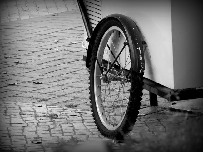 Bicycle Wheel Bokeh Check This Out Close-up Cropped Day Detail Eye4photography  EyeEm Best Shots EyeEm Gallery Focus On Foreground From A Distance Ice Cream Cart Mode Of Transport No People Outdoors Parked Parking Part Of Pavement Patterns Selective Focus Stationary Tire Tranquility Wheel