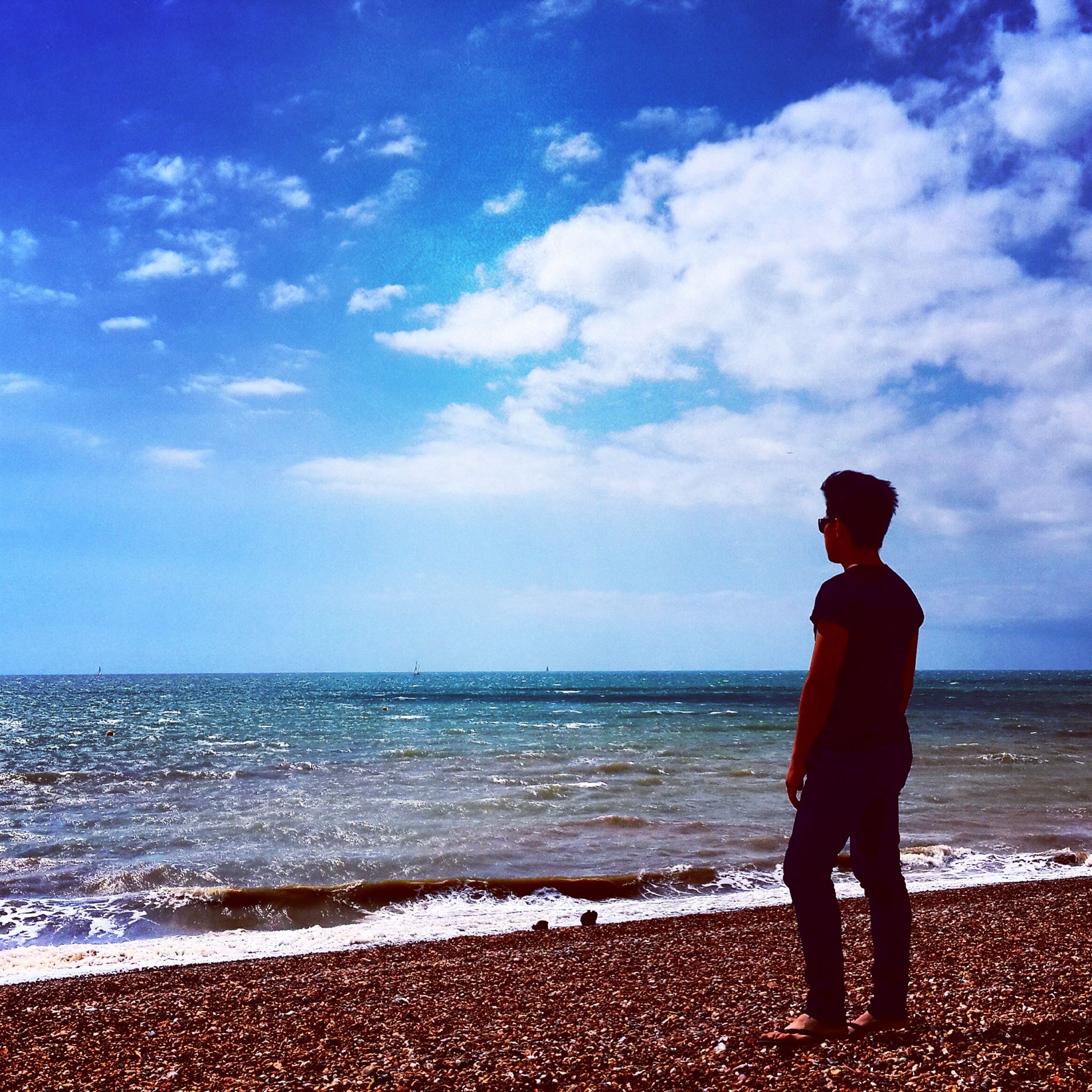 sea, beach, horizon over water, water, shore, sky, full length, standing, rear view, beauty in nature, tranquility, tranquil scene, leisure activity, scenics, lifestyles, cloud - sky, nature, sand