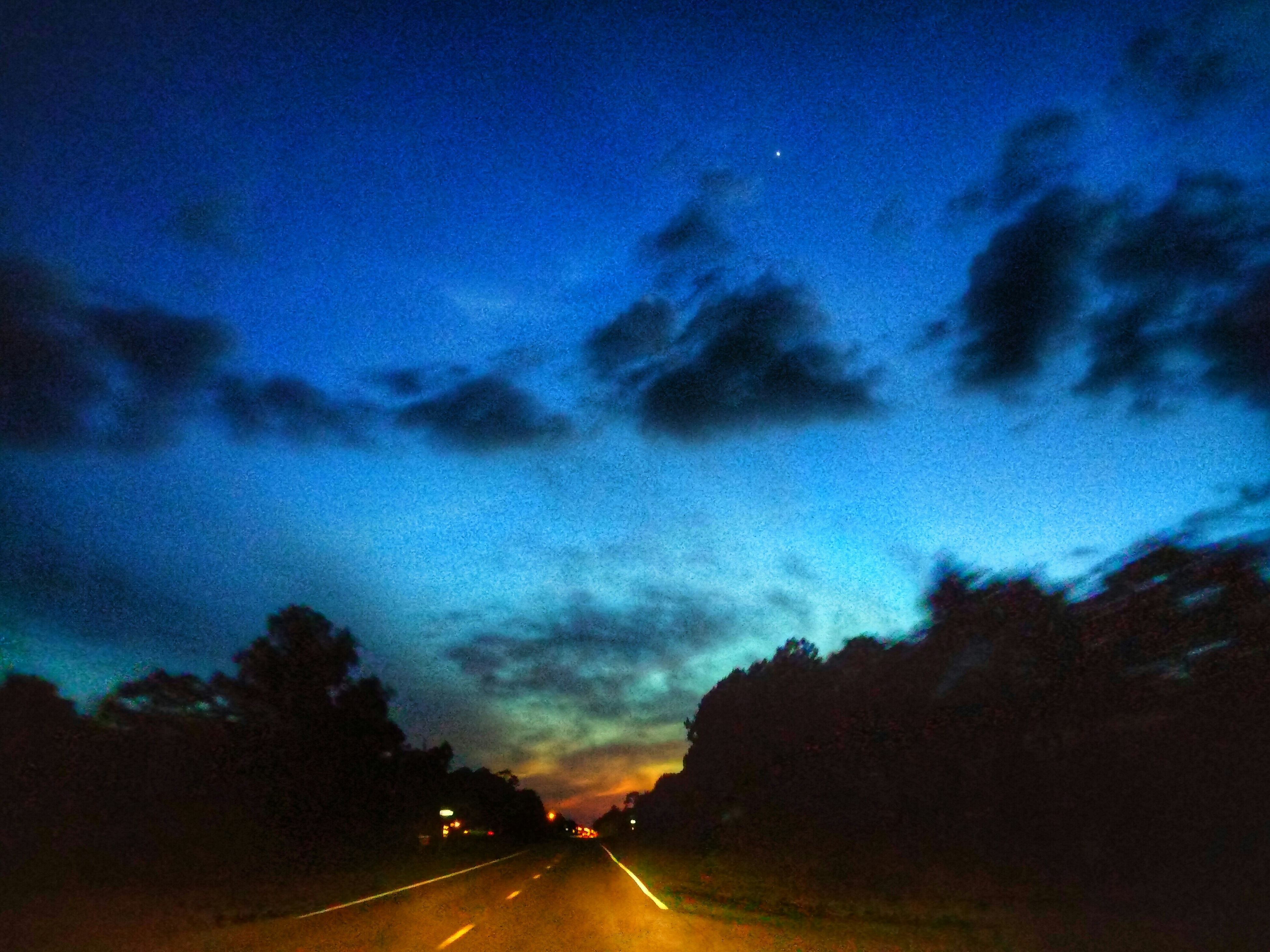 transportation, the way forward, sky, road, cloud - sky, diminishing perspective, vanishing point, car, road marking, cloudy, cloud, dusk, dramatic sky, silhouette, land vehicle, nature, street, sunset, outdoors, illuminated