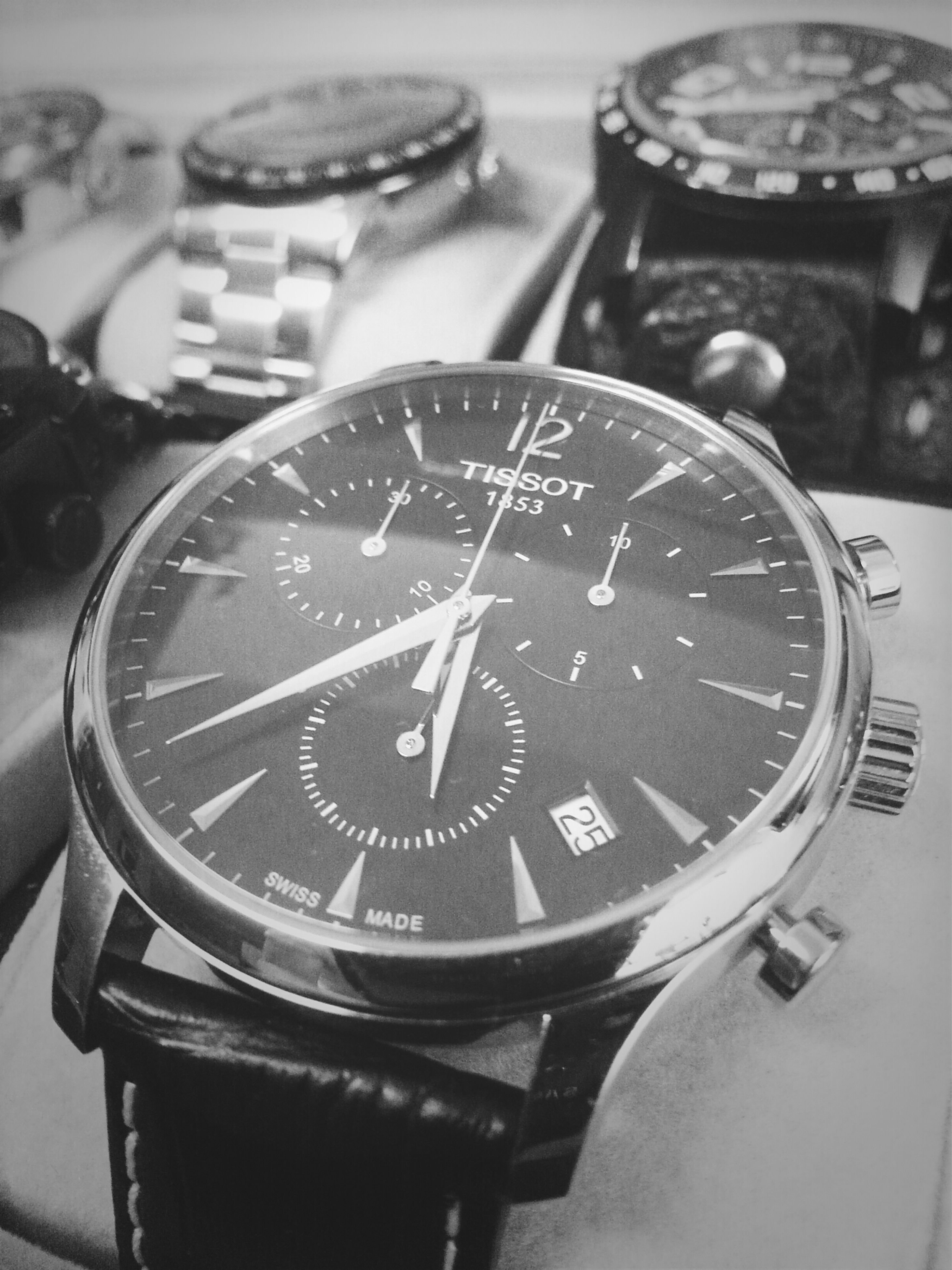 text, communication, close-up, number, indoors, western script, time, focus on foreground, clock, accuracy, selective focus, clock face, technology, single object, non-western script, still life, old-fashioned, instrument of time, minute hand, metal