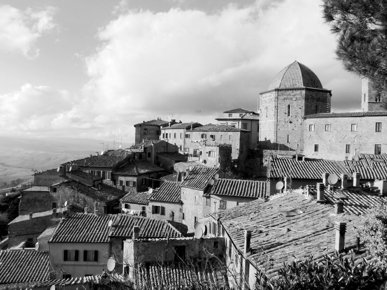 Panorama of Volterra village, province of Pisa . Tuscany, Italy . Black and white photo Alabaster Ancient Antique Architecture Civilization Etruscan Hamlet High Hill Historic Italy Medieval Panorama Pisa Road Skyline Stony Tourism Tower Town Travel Tuscany View Village Volterra