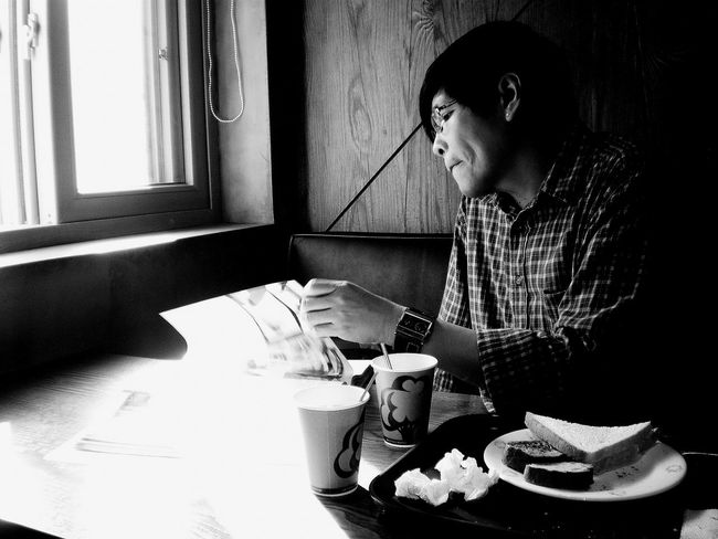 Monochrome Photography Indoors  Window Sunlight One Person One Man Only Person Adult Portrait Photography Bnwportrait Eyeemphoto Reading Relaxing Shadows & Lights Natural Light Portrait Natural Lighting Hobby Interests Bookworm Studying Cafe By The Window