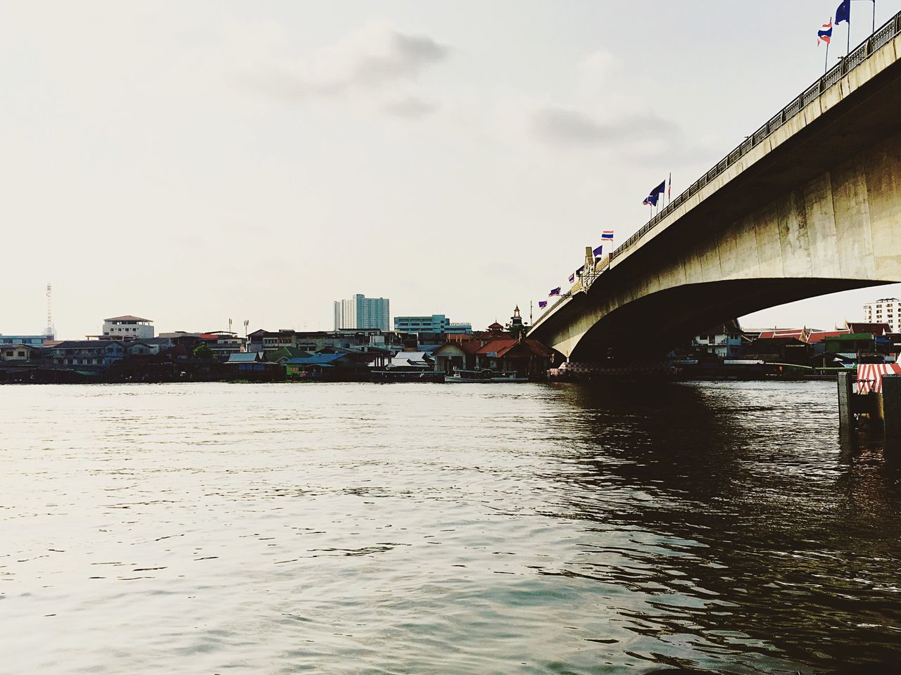 bridge - man made structure, connection, architecture, built structure, transportation, river, sky, water, waterfront, cloud - sky, outdoors, rippled, day, no people, building exterior, city, nautical vessel, nature