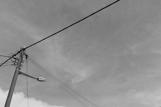 Streetphoto_bw Black & White Black And White Blackandwhite Lookingup Simplicity Minimalism Roadlamp Power Lines Walking Around On The Streets Taking Photos From My Point Of View Eye4photography  EyeEm Gallery EyeEm Best Shots Mobilephotography Showcase: February