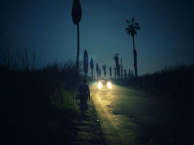 Dama de negro. Nightphotography Smartphonephotography Dark Blue Chorrillos Peru First Eyeem Photo Road Light Car Alone In The City