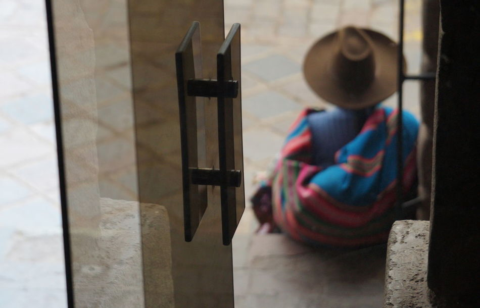 Chola Cusco, Peru Door Focus On Foreground Hat Multi Colored Reflection Woman Back Woman Sitting