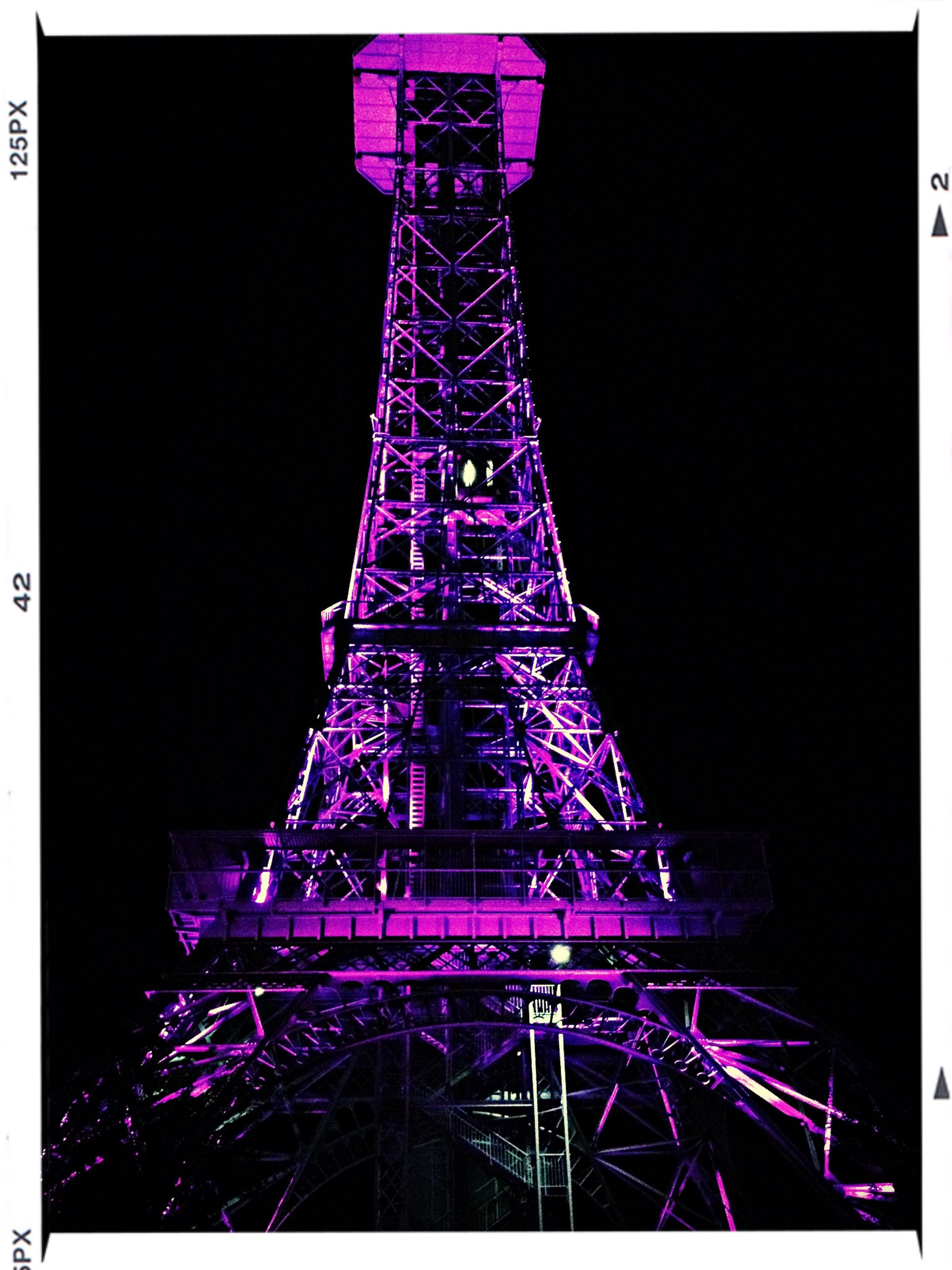 transfer print, illuminated, low angle view, night, amusement park, built structure, auto post production filter, eiffel tower, amusement park ride, clear sky, tower, architecture, arts culture and entertainment, metal, famous place, tall - high, travel destinations, blue, sky, international landmark