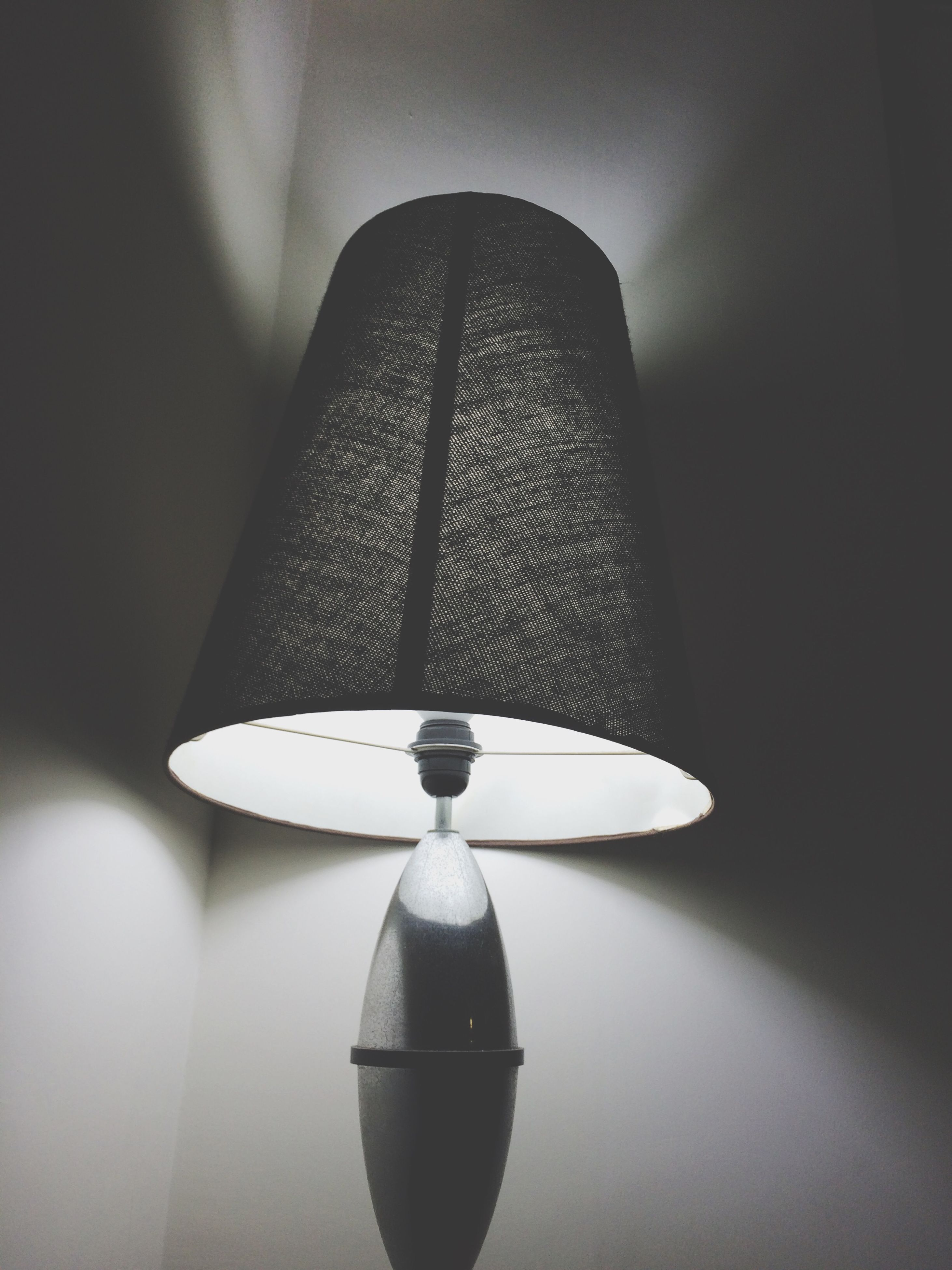 indoors, lighting equipment, illuminated, low angle view, ceiling, electricity, electric lamp, electric light, hanging, lamp, light bulb, architecture, home interior, built structure, glowing, light - natural phenomenon, pendant light, decoration, no people, modern